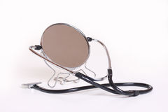 Mirror and stethoscope. Man considered himself to be objective and self-critical Royalty Free Stock Photography