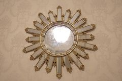 Mirror of the sun on the wall. Mirror sun wall design styling antiques antiquity object interior item interior object item of interior furniture furnishings stock photos