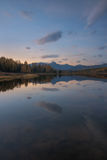 Mirror Surface Lake Vertical Orientation Autumn Landscape With Mountain Range In Early Eveing With Stars On The Sky royalty free stock photos