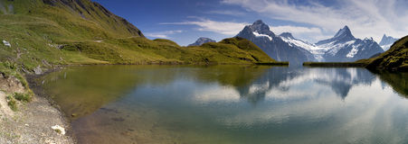 Mirror in Swiss lake Bachalpsee Stock Images
