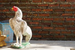 Mirror tile decorative chicken. With brick wall background royalty free stock photos