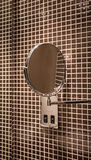 Mirror in tiled bathroom Royalty Free Stock Photography