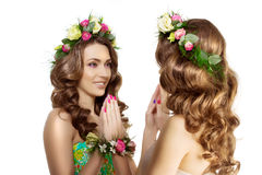 Mirror Two Spring women Young  Girl flowers Beautiful model wrea Stock Images