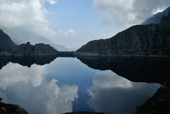The mirror under the sky. The lake Chiotas under the sky in mountain Stock Photo