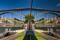 Mirror view of bridge over the river Stock Photography