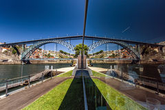 Mirror view of bridge over the river Stock Photos