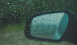 Mirror view of the machine in rainy weather. royalty free stock images