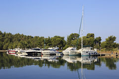 Mirror view of yachts and boats. Royalty Free Stock Photography