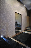 Large mirror on the wall. Angle view of a large mirror on the textured wall inside hotel royalty free stock images