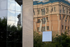 Mirror Wall. A building's distorted reflection on a mirror wall Royalty Free Stock Photography