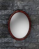 Mirror on the wall. Illustration of an empty mirror hanging on a stone wall Royalty Free Stock Photo