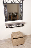 Mirror on a wall and stool Royalty Free Stock Photography