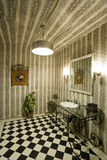Mirror And Washbasin By Light Over Checked Floor Stock Photo