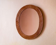 Mirror in wicker frame Royalty Free Stock Image
