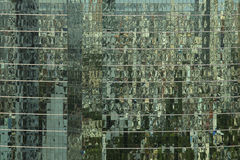 Mirror windows on a modern office building making a background p Stock Images