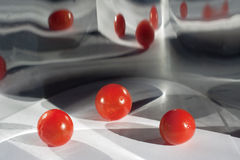 Mirrored 3D red balls. An abstract, three-dimensional rendering of three red balls with mirroring Royalty Free Stock Image