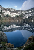 Mirrored Alpine Lake Stock Images