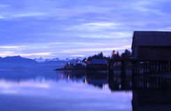 Mirrored Beach Cabins. In Petersburg, Alaska with snowy mountains in the background stock images