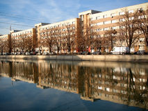 Mirrored blocks 2. City blocks of flats reflecting in river Stock Photography
