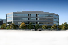 Mirrored Business Building and Parking Lot Royalty Free Stock Images