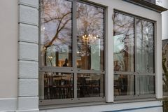Mirrored cafe window facade with lustre at evening. In historical city of south germany stock image