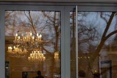 Mirrored cafe window facade with lustre at evening. In historical city of south germany royalty free stock image