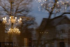 Mirrored cafe window facade with lustre at evening. In historical city of south germany royalty free stock photos