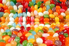 Assortment of sweet candy on a mirror. multi colored jelly candies on a mirror background. stock image