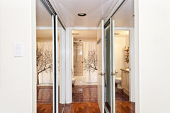 Mirrored closets and bathroom Stock Images