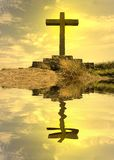 Mirrored cross silhouette. On top of the mountain Stock Image