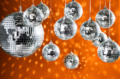Mirrored disco balls with light spots Stock Photography