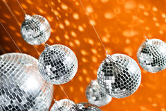 Mirrored disco balls with light spots Stock Photos