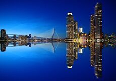 Mirrored Image of High Rise Buildings and Bridge Stock Images