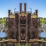 Mirrored image industrial metal silos for fuel royalty free stock image