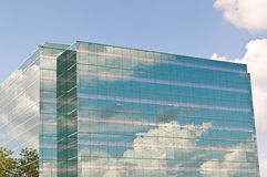 Mirrored Office Building Reflecting the Clouds Royalty Free Stock Image