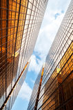 Mirrored office buildings with blue sky and clouds, Hong Kong Royalty Free Stock Images