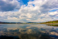 Mirrored Sky. Beautiful sky reflected on calm river waters Royalty Free Stock Photos