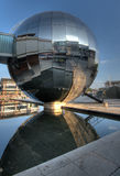 Mirrored spherical building reflects in water. Mirrored spherical artistic building reflects in water. Near Bristol harbourside, England Royalty Free Stock Photography