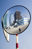 Mirroring construction. And foreman in a black suit Royalty Free Stock Photos