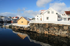 Mirroring in henningsvaer. Houses mirroring in the calm water of Henningsvaer's harbour royalty free stock images