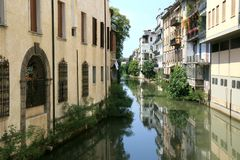 Mirroring houses in canal of Padua, Italy Stock Photos