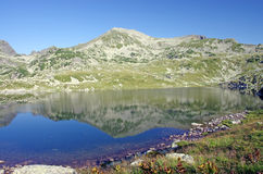 Mirroring mountain. Reflexion in Bucura lake, Retezat National Park Stock Photo