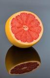 Mirroring an orange Stock Photography
