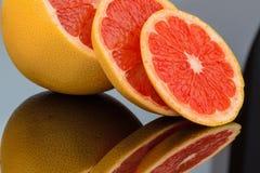 Mirroring an orange Royalty Free Stock Photo