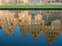 Mirroring of the salt storages of Luebeck, Germany, in water. Mirroring of the salt storages of Luebeck, Germany, in river Obertrave Stock Photos