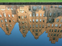 Mirroring of the salt storages of Luebeck, Germany, in water Stock Image