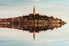 Mirroring skiline of the old town of Rovinj, Istria, Croatia. Abstract skiline of the old town of Rovinj, Istria, Croatia mirroring in the sea water. Rovinj city royalty free stock photos