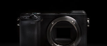 Mirrorless camera body on black background Royalty Free Stock Images