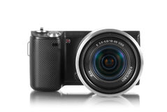 Mirrorless camera with lens. Mirrorless photo camera with lens mounted stock image