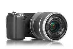 Mirrorless camera with lens. Mirrorless photo camera with lens mounted stock photo